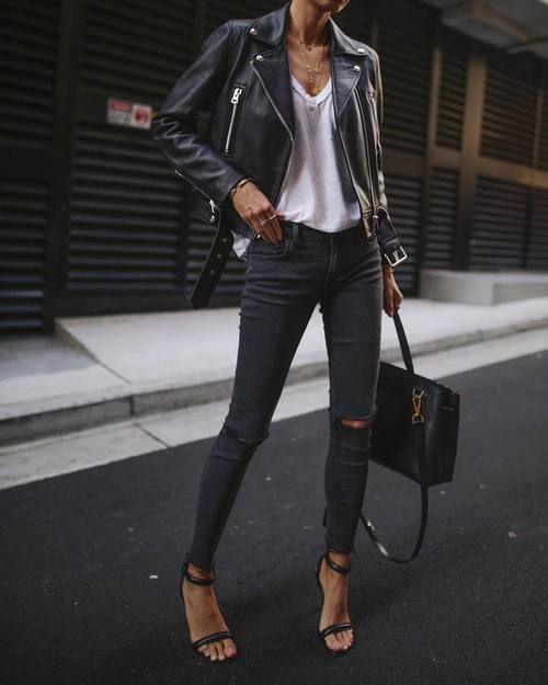 jaqueta de couro e calça preta