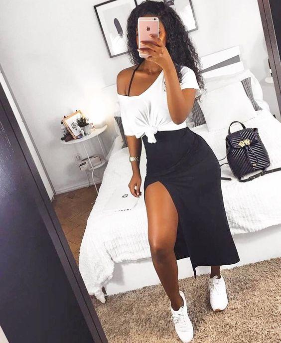 tubinho preto, sobreposição com blusa branca e tênis branoc