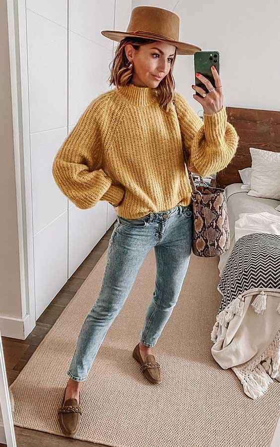 suéter amarelo, chapéu fedora, calça jeans skinny