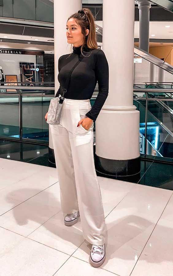 looks de frio com blusa de gola alta e calça branca