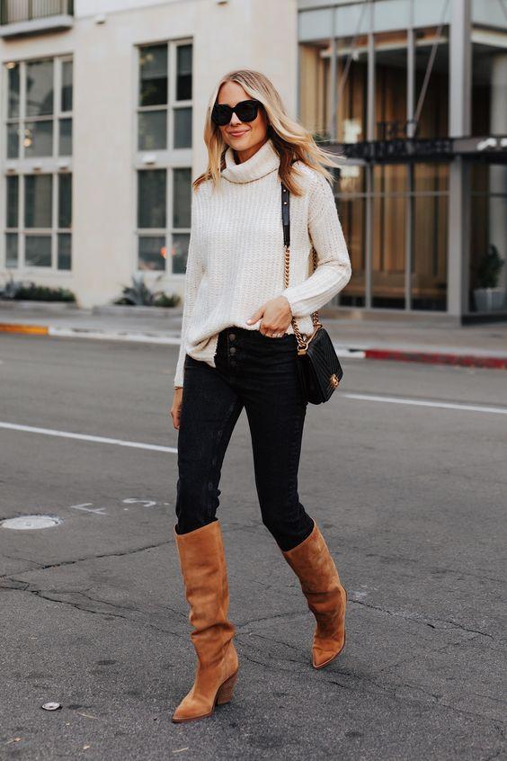 blusa de bolaa alta, calça skinny e bota de cano alto