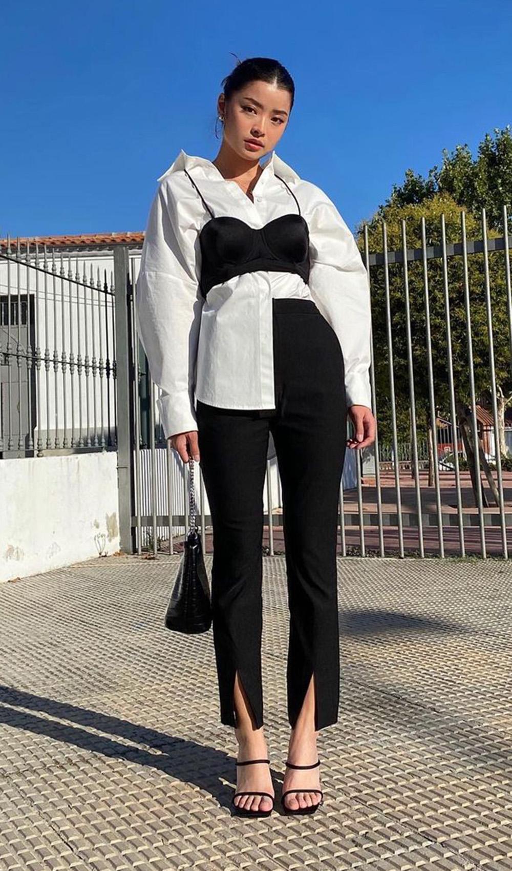 sobreposição com top preto e camisa branca, calça preta e sandália de tiras